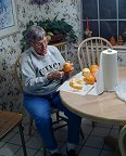 Mom peels oranges to start the chocolate-covered candied orange rind